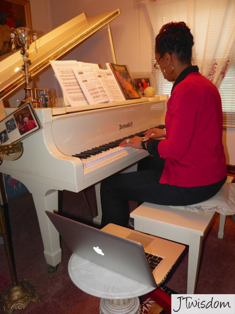 JT going over her piano class session